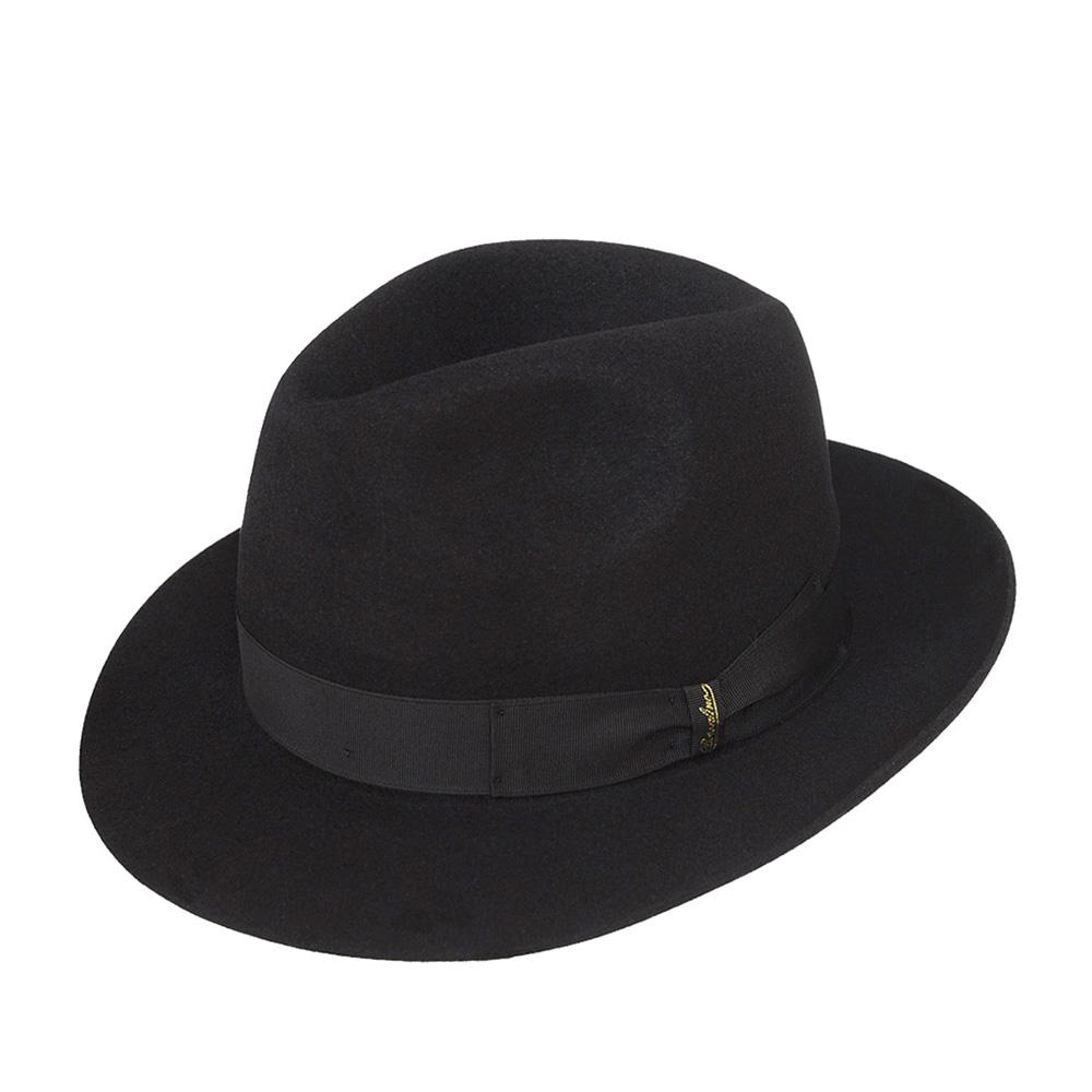 Шляпа федора BORSALINOШляпы<br>Бренд Borsalino с середины XIX века изготавливает, пожалуй, самые узнаваемые и почитаемые во всём мире головные уборы. Создаются шляпы исключительно вручную, на исторической родине - в Италии, из материала высочайшего качества - пуха кролика. Мы с гордостью и уважением к старинному итальянскому бренду представляем Вам роскошную федору Marengo. Эта классическая шляпа выглядит очень изящно и актуально. Модель лёгкая, максимально комфортно садится на голову. Поля с неотстроченным краем отлично держат форму, их можно изгибать, по желанию, и вверх, и вниз. Тулья украшена репсовой лентой с бантом двойной складки, который отмечен золотистым логотипом - надписью Borsalino. Внутри шляпы пришита лента, для удобной посадки на голову. Высота тульи - 12,7 см, ширина полей - 6,3 см.