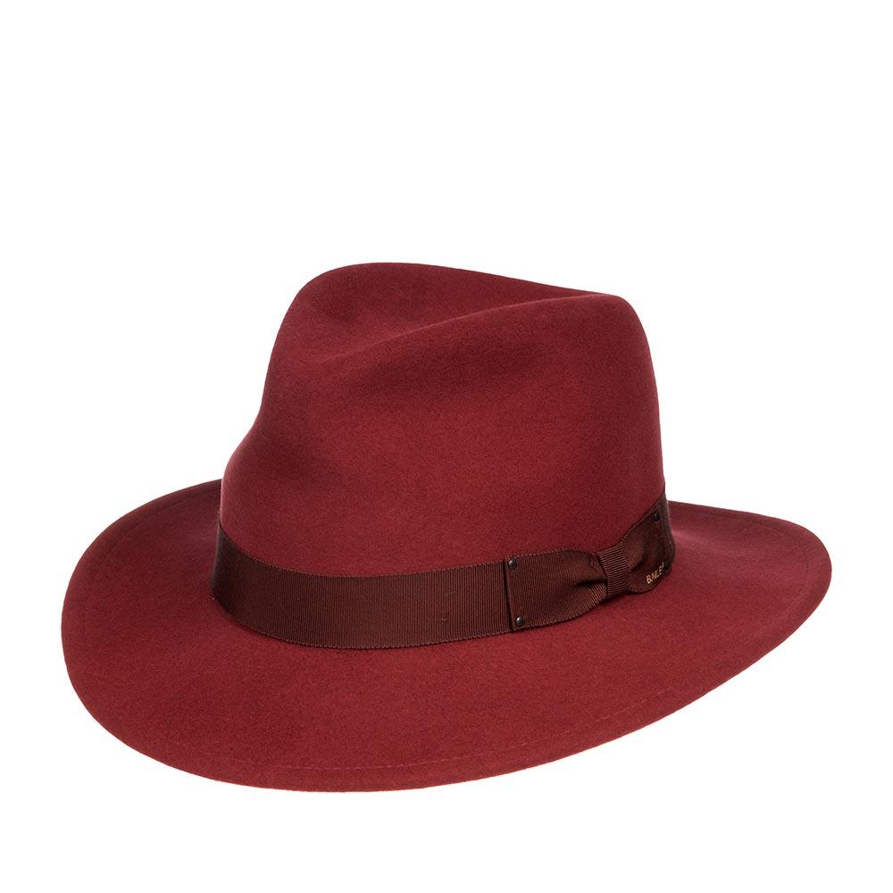 Шляпа федора BAILEYШляпы<br>Curtis - классическая федора с полями средней длины! В этой шляпе можно наблюдать идеальное сочетание стиля и функциональности головного убора для частого ношения! Модель сделана из высококачественного фетра в США, с применением уникальной технологии Lite Felt - это революционная пропитка, которая добавляет материалу водоотталкивающие свойства и способность дольше сохранять и быстро восстанавливать форму. Мягкие поля этой шляпы можно немного опускать вниз, тогда головной убор приобретает красивые плавные линии и будет слегка прикрывать глаза, либо поднимать вверх для более открытого, молодёжного образа. Шляпа украшена японской шелковистой лентой гро-гро с бантом сбоку. Внутри шляпы пришита лента для удобной посадки на голову. Высота тульи: 11 см в видимой части, ширина полей - 6 см.