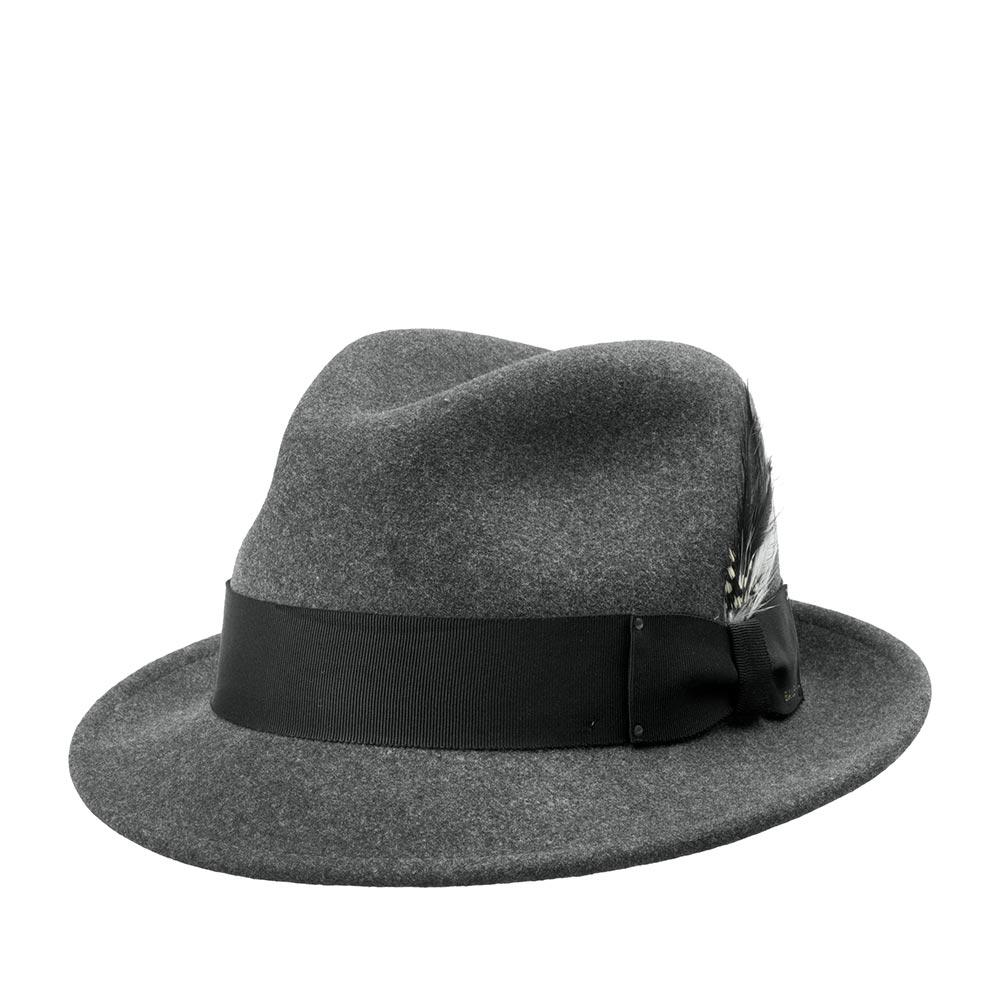 Шляпа трилби BAILEYШляпы<br>Tino - федора с короткими полями для привлекательного образа! Эта шляпа сочетает стиль и функции головного убора для частого ношения! Сделана из высококачественного фетра в США, с применением уникальной технологии Lite Felt - это революционная пропитка, которая добавляет головному убору водоотталкивающие свойства и способность дольше сохранять и быстро восстанавливать форму. Дизайн этой шляпы - один из самых модных трендов вот уже несколько сезонов. За счёт небольших полей эта модель имеет много вариантов ношения, органично смотрится и подходит ко многим стилям одежды. Поля Tino можно полностью поднимать на верх, либо опускать переднее поле вниз для создания таинственного вида. Шляпа украшена съёмным пером и японской шелковистой лентой гро-гро с бантом сбоку. Внутри пришита лента для удобной посадки на голову. Высота тульи: 11,5 см в видимой части, ширина полей - 4,5 см.