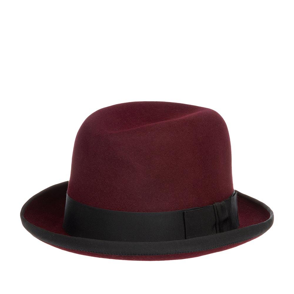 Шляпа хомбург CHRISTYSШляпы<br>Homburg - ультрастильный хомбург от Christys приглушённого, бордового цвета. Эта модель не оставит Вас равнодушными! Изготовлена вручную в Великобритании из материала высочайшего качества - пуха кролика. Особенность шляпы в её quot;open crownquot; конструкции, за счёт пластичности которой Вы можете придать куполообразной тулье шляпы индивидуальную форму просто с помощью пальцев, подогнав размер, высоту и посадку шляпы под свои вкусы и предпочтения. Аксессуар хорошо держит форму. Поля зафиксированы в положении вверх, их край отстрочен репсовой лентой. Christys даёт шанс всем любителям головных уборов побыть дизайнером, создав личный аксессуар, и показать окружающим свой стиль и аутентичность! Тулья модели лаконично украшена чёрной репсовой лентой с бантом. Внутри головного убора пришита лента из кожи для самой удобной посадки на голову и неизменно роскошная, шелковистая подкладка ярко-красного цвета с логотипом бренда. Высота тульи - 12,5 см, ширина полей - 5 см.
