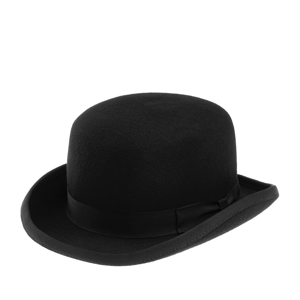 Шляпа котелок CHRISTYSШляпы<br>WOOL FELT BOWLER - классический английский котелок. Модель сделана из высококачественного фетра. BOWLER украшен тонкой репсовой лентой с бантом сбоку. Короткие поля модели слегка вздёрнуты вверх, края обработаны той же лентой. Внутри пришита алая подкладка с фирменной эмблемой CHRISTYS. Такой вариант подкладки является визитной карточкой этого бренда. Высота тульи 10,5 см, ширина полей - 4 см.